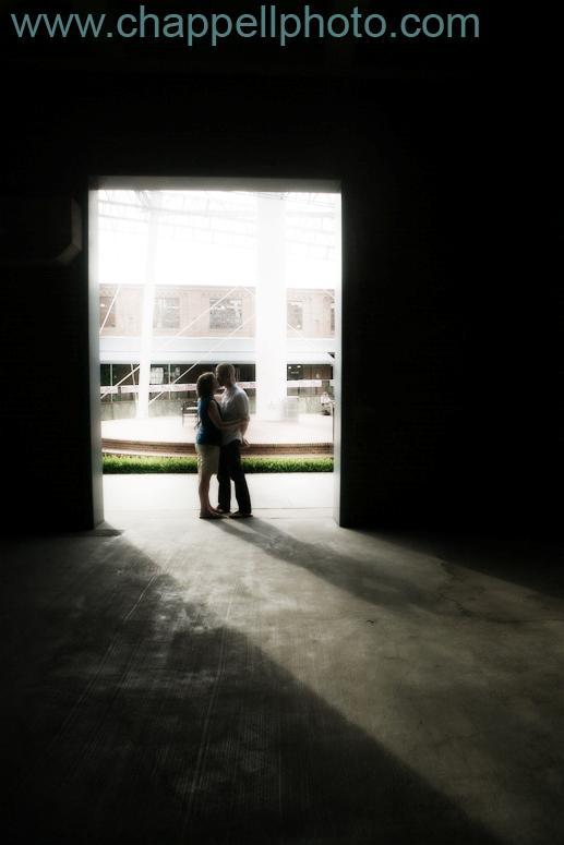 Romance-in-the-shadows-wedding-photography-black-white-teal-bride-groom-kiss-in-doorway.full