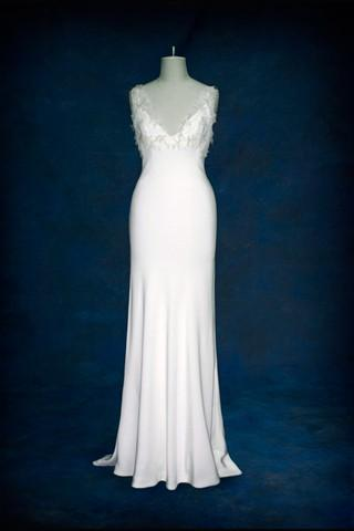 Stunning white bias cut wedding dress with understated feather ...