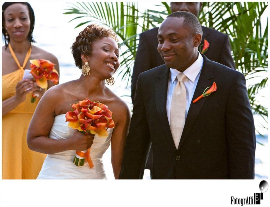 The orange calla lillies perfectly compliment the bridesmaid's yellow bridesmaid's dress, and the br