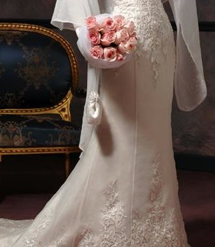 The mermaid style and lace detail on this wedding dress skirt may work well with a different wedding