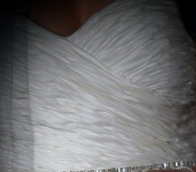 You may love the rouching and sweetheart neckline on this white wedding dress bodice.