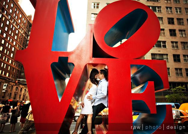 Monumental-locations-red-love-monument-in-center-of-city-bride-groom-in-love.full