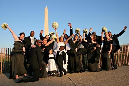 Monumental-locations-entire-wedding-party-with-bride-groom-blue-sky-monument-in-background.full