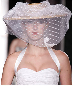Carolina Herrera: Straw hat wrapped in ivory point d'spirit netting