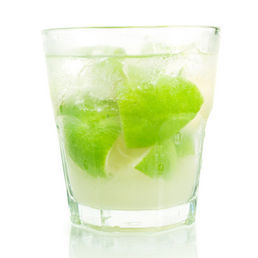 A refreshing caiprinha with lime, mint, and ice in a glass.