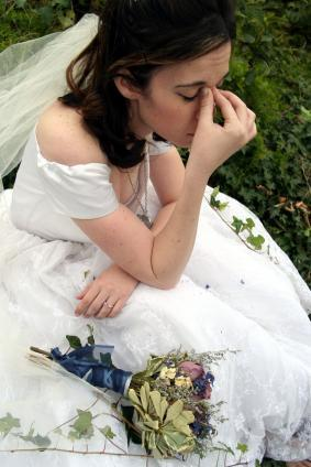 Even a beautiful wedding dress with a veil and a dried flower bouquet can't keep your bride from str