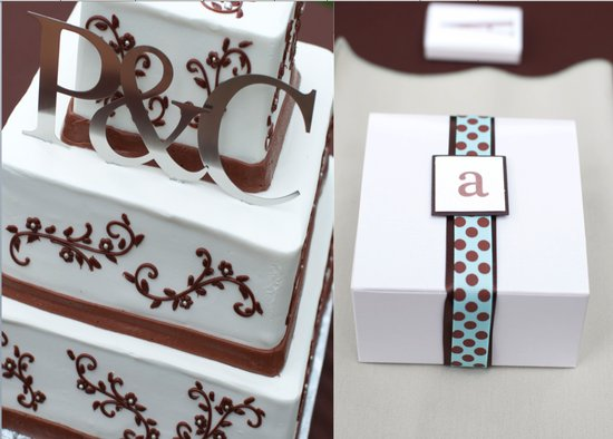 Brown and white three tiered square wedding cake with gold initials and favor box with brown and blu