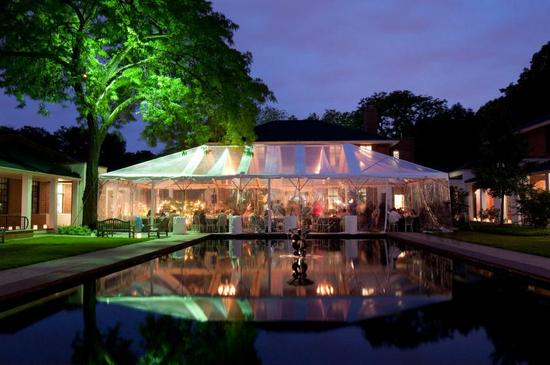Outdoor wedding tent at night with visible lights