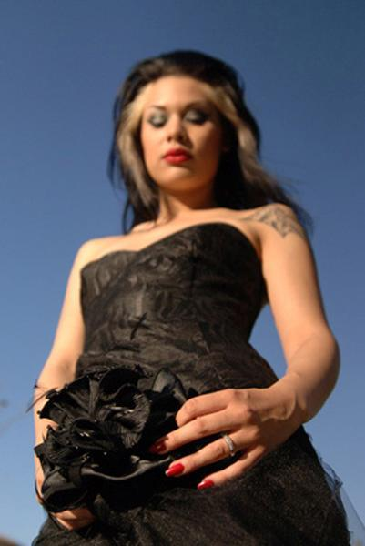 Rock n roll black lace strapless wedding dress, edgy bride with red lips and nails
