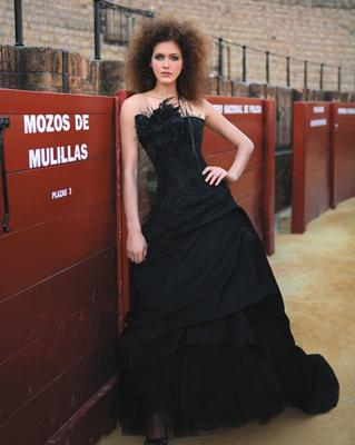 Edgy strapless black wedding dress, feather detail on bodice, gothic feel