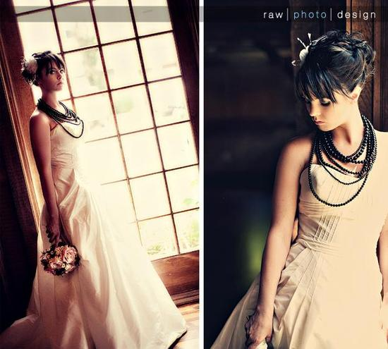 Bride poses in dark library with black pearl necklace and white flower and feather hair accessory