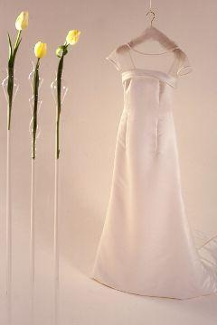 Classic look- simple white modified A-line dress with sheer shoulders; yellow tulips