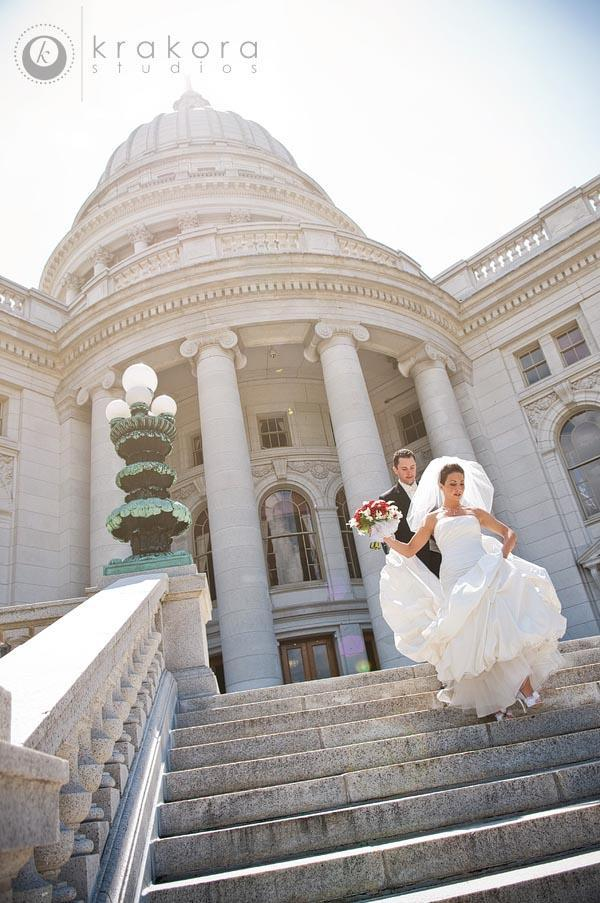 Madison-wisconsin-bride-groom-outside-capital-building-red-white-bouquet.full