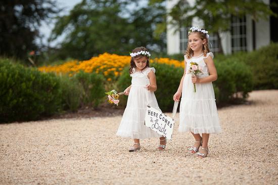 flower girls hold sign during ceremony keswick vineyard virginia