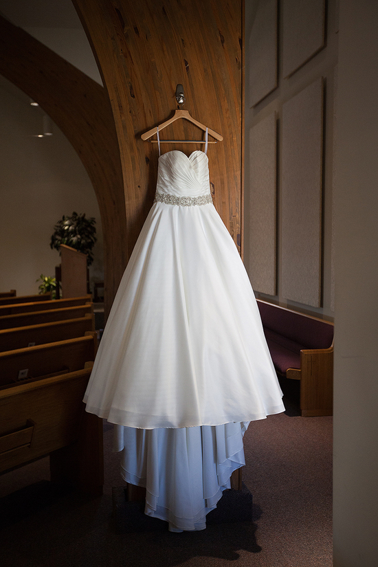 white and diamond wedding dress in church