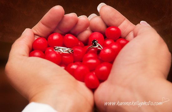 Wedding-Rings-in-Heart-Shaped-Hands-by-Durango-Wedding-Photographers-logo