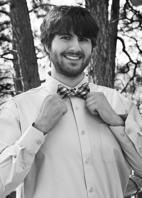 Groom showing off bow tie 2400 px