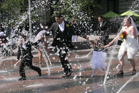 Bride, Groom, Flower Girl and Ring Barrer Running through fountains