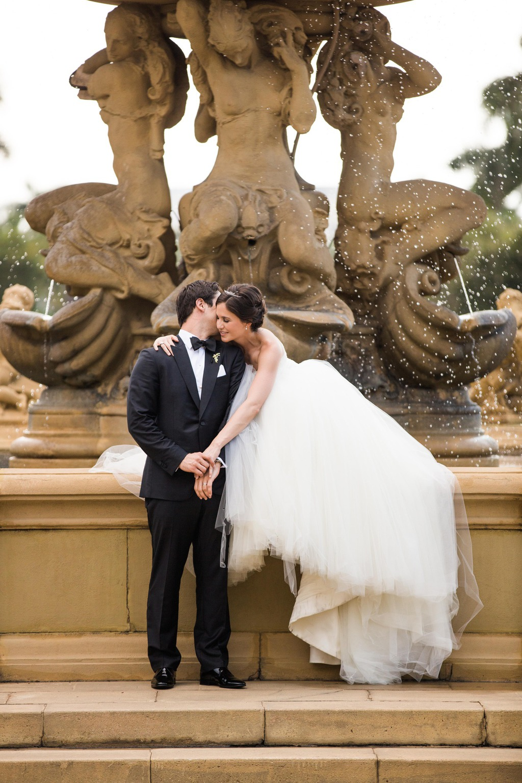 Bride and Groom in front of fountain
