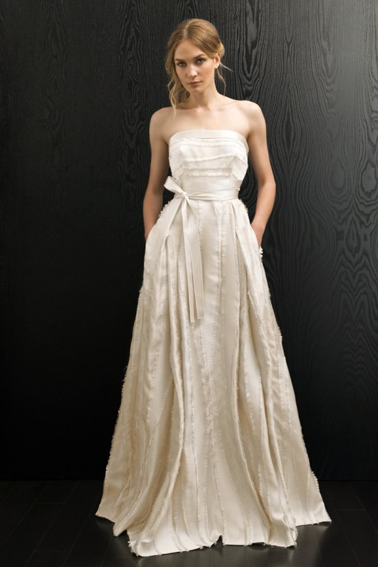 Ivory feathered wedding dress by Amanda Wakeley