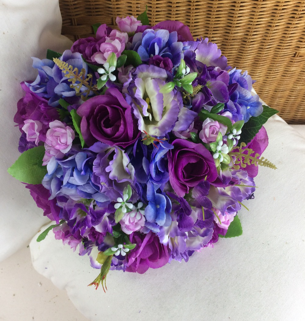 Artificial wedding bouquet of blue, violet & purple flowers