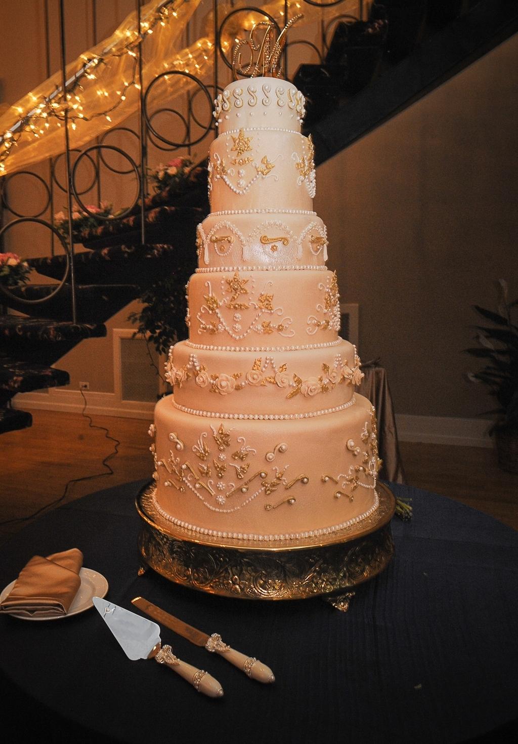 Regal-6-tier-champagne-ivory-wedding-cake-fairytale-inspired-monogram-cake-topper.full