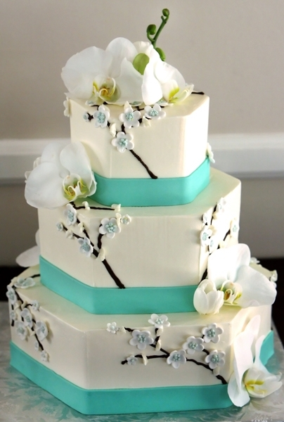 Tropical-wedding-cake-white-three-tier-aqua-ribbon-white-orchids.full