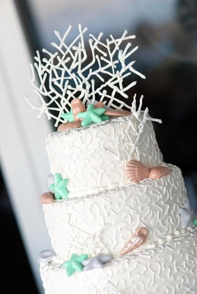 Tropical-wedding-cake-coral-cake-topper-white--cake-with-taupe-aqua-silver-shells.full