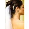 Bridal-hairstyle-pulled-back-up-do-twists-with-rhinestone-hairclip-veil.square