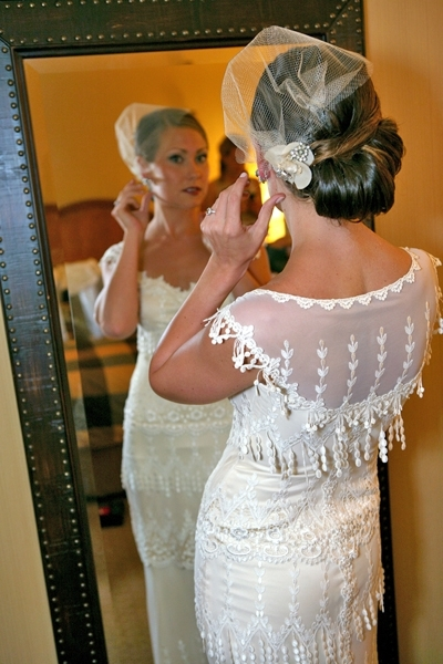 Bridal-hairstyle-up-do-vintage-chic-birdcage-veils-tucked-under-on-the-side.full