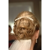 Bridal-hairstyle-updo-pearl-barret-messy-curls.square