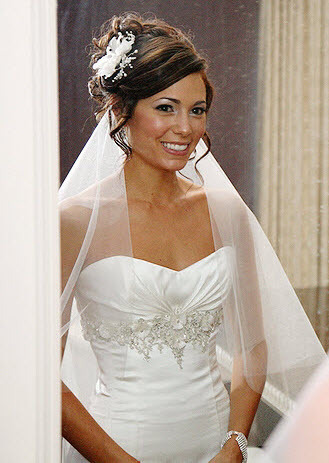 Wedding-hairstyle-sideswept-updo-with-tendrils-white-fabric-flower-in-hair.full