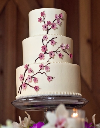 White-wedding-cake-three-tier-with-branch-design-and-cherry-blossoms.full