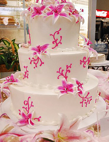 photo of White and Pink Tropical Wedding Cake