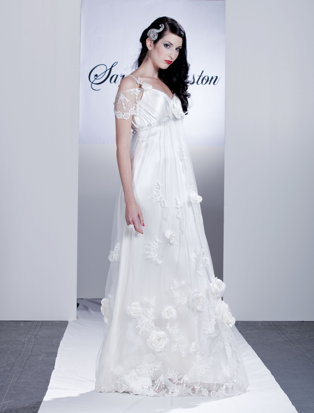 Wysteria-white-wedding-dress-large-floral-rosette-appliques-on-skirt-off-the-shoulder-sheer-lace-sleeves.full