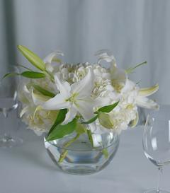 photo of White Hydrangea & Lily Centerpiece
