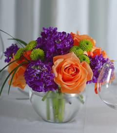photo of Orange Rose & Purple Stock Centerpiece