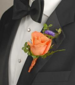 photo of Orange Rose & Purple Aster Boutonniere