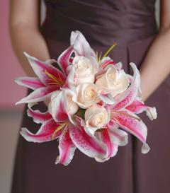 photo of White Rose & Stargazer Lily Bridesmaid Bouquet