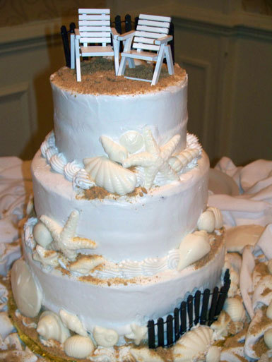 Life-is-a-beach-beach-themed-wedding-cake-seashells-sand-white-tan-beach-chair-cake-toppers.full