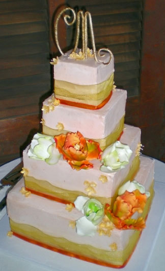 Sunny-white-square-4-tier-wedding-cake-with-yellow-and-orange-ribbon-monogram-cake-topper.full