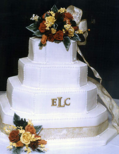 Touch-of-gold-classic-white-stacked-wedding-cake-piping-gold-monogram-autumn-flowers-on_top.full