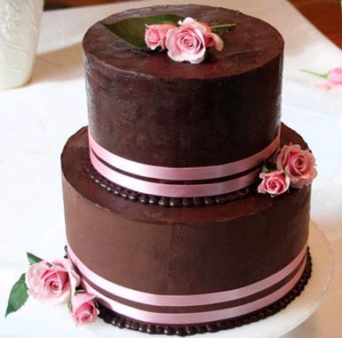 Chic-chocolate-brown-wedding-cake-pink-ribbon-pink-roses.full