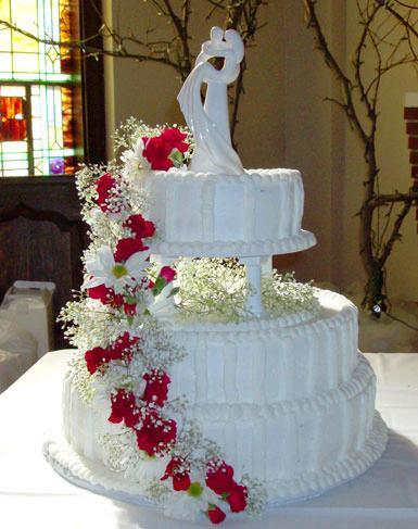 Red-white-formal-wedding-cake-with-cascasing-flowers.full