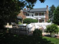 Back_of_property_with_chairs_for_ceremony.full