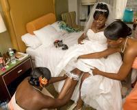118_bridesmaids_dressing_the_bride.full