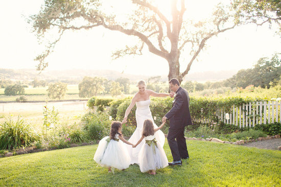 rustic elegant real wedding outdoor wedding ceremony bride groom with flower girls