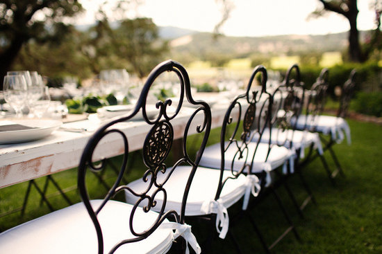 rustic elegant real wedding outdoor wedding ceremony reception seating