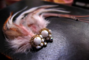 photo of Feather bridal fascinator with milk glass details