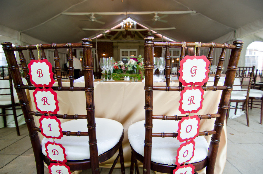 Tented-wedding-reception-bride-groom-chairs-at-sweetheart-table.full